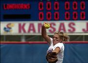 Kassie Humphreys tossed a one-hitter and a shut-out into the top of the 7th inning against Texas before Amber Hall's homerun  lifted Texas to a 1-0 win over Kansas Saturday in front of a record crowd at Arrocha Ballpark.