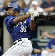 Kansas City Royals' right fielder Emil Brown hits in two runs in the first inning of an MLB baseball game with the Cleveland Indians, Saturday, April 22, in Kansas City, Mo.