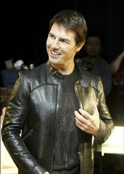 "This photo, supplied by ABC, shows new father Tom Cruise joined the cast of ""Mission Impossible  III"" for an interview  with ABC News&squot; Deborah Roberts, in Los Angeles, Thursday night, April 20, 2006,to discuss the highly anticipated movie. The interview  is one of the first that Tom Cruise participated in since the birth of his daughter. An abbreviated  ""20/20"" television magazine show airs at a special time on Friday night, April 21,  on  ABC Television Network. The film opens in U.S. theaters on May 5."
