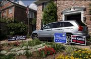 A house in the Uptown area of New Orleans, has signs for both candidates after last night's primary election on Sunday, April 23, 2006. New Orleans Mayor Ray Nagin will face Lt. Gov. Mitch Landrieu in a runoff election on May 20th.