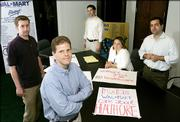 "From left, Brendan Bush, Paul Blank, Jeremy Bird, Buffy Wicks, and Chris Kofinis, of Wake Up Wal-Mart stand in their office in Washignton in this July 19, 2005 file photo. Wake Up Wal-Mart and Wal-Mart Watch are running a campaign to pressure the world&squot;s largest retailer, Wal-Mart,  to be a better employer and corporate citizen. A year-old effort to force the nation&squot;s No. 1 private employer to change its business practices has evolved into a Washington-style brawl: tens of millions of dollars spent by Republican and Democratic political consultants using polling, micro-targeting, ads, e-mails, direct mail, grass-roots organizing and strategic ""war rooms"" to ply their trade in the corporate world."