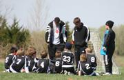 KVF Blye coach Kyle Glick gives a pep talk to his team after their April 8 loss during the Kaw Valley Cup Tournament. The KVF Blue has spent the last several months adjusting to the level of play in the Premier league.
