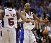Los Angeles Clippers Sam Cassell, right, celebrates with teammate Cuttino Mobley after successful defense against the Denver Nuggets in the first quarter of their first round Western Conference playoff basketball game, Monday, April 24, 2006, in Los Angeles.