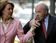 Enron founder Kenneth Lay keeps hold of his wife Linda's hand on their to the federal courthouse on the first day of the 13th week of his fraud and conspiracy trial Monday, April 24, 2006 in Houston. Lay is expected to take the stand later in the day.