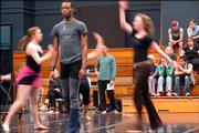 Wally Cardona, background center, a choreographer from New York, observes a rehearsal of his work with the KU University Dance Company for a Spring Concert in April. Cardona was in town for the last week doing a residency with KU dancers.