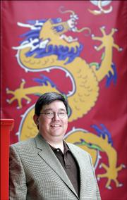 Bill Tsutsui will be the exectutive director of the Confucious Institute, which will open in August at Kansas University.  The institute will provide chinese language instruction and programs on Chinese culture.  Tsutsui is pictured on Tuesday in front of a banner of a Chinese dragon outside the Spencer Museum of Art at KU.