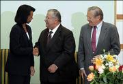 Secretary of Defense Donald Rumsfeld, right,  looks on as US Secretary of State Condoleezza Rice shakes hands with Iraqi President Jalal Talabani at the Presidential Council Office in Baghdad, Iraq, Wednesday April 26, 2006. Rice and Rumsfeld are in Baghdad to meet with US officials and in support of the new Iraqi government officials.