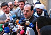 "Iraqi prime minister designate Nouri al-Maliki speaks to the press after a meeting with revered Shiite cleric Grand Ayatollah Ali al-Sistani Thursday April 27, 2006 in Najaf, 160 km (100 miles) south of Baghdad.  Al-Sistani urged al-Maliki to improve security and to form a government of leaders who will put the national interest above ""their personal, party or sectarian interests."""