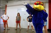 Baby Jay, Kansas University mascot, right, demonstrates a routine during tryouts. About 11 people attended the first day of tryouts for Big Jay and Baby Jay. Eight people will be selected as mascots for KU. Friday night's tryouts were held on the second floor of Allen Fieldhouse.