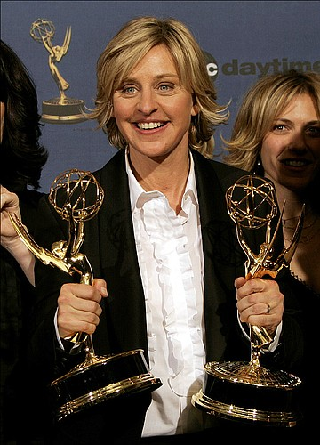 "Ellen DeGeneres holds the awards for outstanding talk show host and outstanding talk show, for her work on ""The Ellen DeGeneres Show,"" backstage at the 33rd Annual Daytime Emmy Awards in Los Angeles on Friday, April 28, 2006."
