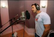 "Puerto Rican singer Carlos Ponce sings on a track while recording a Spanish-language version of the U.S. national anthem, Wednesday, April 26, 2006 in Miami. The recording, dubbed ""Nuestro Himno,"" which means ""Our Anthem"" in English, is set to ""rhythmic Latin musical arrangement"" but respects the song&squot;s traditional structure, said Adam Kidron, who heads the record label Urban Box Office."