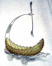 This castor set looks like a canoe on a silver wagon. It was made by Homan Silver Plate Co. in the 1890s and was offered for sale this year by Pansy's Elegant Glass at RubyLane.com for $1,650.