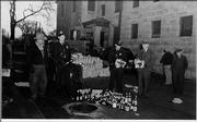 Lawrence law enforcement pour bottles of illegal liquor down the sewer drain outside the sheriff's headquarters in this undated photo.