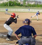 Detonator Jacob Seratte bats April 26 at Youth Sports Inc. The Detonators pounded the Saints 22-1.