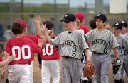 Panthers first baseman Chris Allen leads his team through the high fives after the game. The Panther defeated the Comets April 24 at Youth Sports Inc.