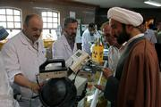 Iranian technicians explain a piece of equipment to a clergyman during an exhibition of Iran's Atomic Energy Organization at Qom University in Qom, 80 miles south of Tehran. Iran has discovered new deposits of uranium and is continuing its nuclear enrichment program despite international protests, a top nuclear official said Tuesday.