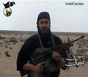 This image made from video shows al-Qaida in Iraq leader Abu Musab al-Zarqawi. The image was provided via the IntelCenter, which is a private contractor working for intelligence agencies. A suspected al-Qaida safehouse was raided Tuesday by U.S. troops hunting for al-Zarqawi.