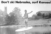 A postcard from Schneider's scrapbook shows him as a mock surfer at KU's Potter Lake.