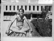 A photo from Schneider's scrapbook shows him in a familiar perch outside Kansas University's Wescoe Hall.