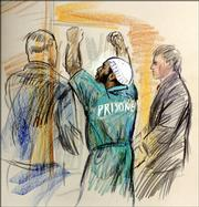 This artist's rendering shows Zacarias Moussaoui celebrating as he is taken from the courtroom at U.S. District Court in Alexandria, Va., after the jury in the sentencing trial of the convicted al-Qaeda conspirator sentenced him to life in prison, Wednesday, May 3, 2006.