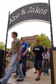 Members of the Free State High School prom court leave a Thursday afternoon pre-prom meeting at Abe & Jake's Landing. Several incidents in recent years at the bar have made news, which is a concern for Lawrence officials because the building is owned by the city and leased to Mike Elwell.