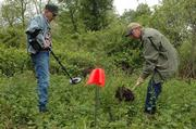 Dick Harmon and Tom Thiessen, workers from Lincoln, Neb., dig at the site of the Battle of Black Jack. Volunteers came Thursday morning to clean and look for signs of the former battleground east of Baldwin.