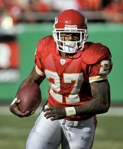 Kansas City Chiefs running back Larry Johnson carries the ball against the Oakland Raiders in his first start of the 2005 season on Nov. 6. Johnson gained 1,627 yards from scrimmage after Nov. 1.