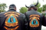 "Wade ""Cream Puff"" Burenheide, left, Baldwin, and Mark ""Buffalo"" Halford, Lawrence, show their Christian Motorcyclists Assn. leather jackets Thursday before riding."