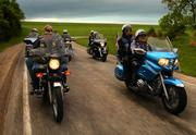 The Lawrence chapter of the Christian Motorcyclists Assn., led by Cal and Donna Field, left, and Russ and Carol Beeson, right, cruise Thursday on a back road near Eagle Bend Golf Course. The local chapter of the international association will participate in a nationwide fundraising event, Run For the Son, on Saturday, which starts in Lawrence at the Slow Ride Roadhouse, 1350 N. Third St., and ends at the Wyandotte County Fairgrounds.