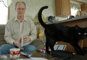 "Charlie Ross, Lawrence, who has bipolar disorder and attention deficit disorder, says it ought to be all right to talk about mental illness. ""I just want people to know what it&squot;s like,"" said Ross, who is pictured at his house with his cat, Frodo. Ross works as a rural outreach specialist with Independence Inc. and is helping to organize this week&squot;s National Alliance on Mental Illness fundraiser walk."