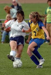 Seabury Academy's Kathy Chung (3) controls the ball while Center Place's Molly Hight defends. The Seahawks won Thursday's game, 4-3, at the Youth Sports Inc. fields.