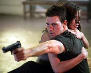 "Tom Cruise protects Michelle Monaghan in the blockbuster sequel ""Mission: Impossible III."""