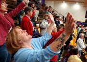 Lawrence resident Carla Parris worships along with hundreds of other attendees at a National Day of Prayer ceremony Friday night at Haskell Indian Nations University.