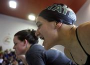 Free State's Bailey Carlson cheers during the Sunflower League swimming and diving meet. Preliminary rounds of the event were held Friday at Knox Natatorium.