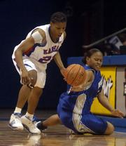Kansas University guard Shaquina Mosely, left, records a steal against New Orleans guard Le'Della English in this file photo from last season. Through she struggled at times last year, Mosely has impressed her coaches during the offseason.