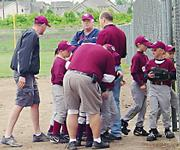 The Clippers head into the dugout after their sixth-run seventh inning against teh Jets on Friday at Youth Sports Inc.