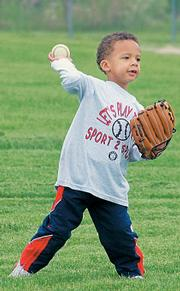 Isaiah Mayo winds up for the throw from third to first Saturday during his session of pre-school T-ball at Sport2Sport.