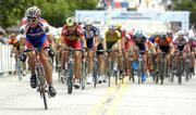 Former Kansas University cyclist Brian Jensen, left, leads the pack on the last lap of the 2005 National Collegiate Cycling Championships in Lawrence. Jensen will miss the 2006 championships because of obligations to the Jelly Belly pro cycling team.