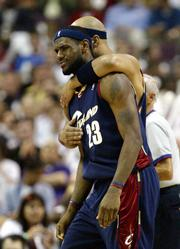 Cleveland Cavaliers forward Drew Gooden comforts teammate LeBron James. The Detroit Pistons frustrated James during the first half of their 97-91 victory over the Cavs on Tuesday in Auburn Hills, Mich. James finished with 30 points.