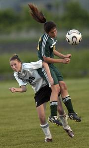 Lawrence High's Becky Davis, left, battles for position with a Shawnee Mission South player.
