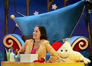 "Melanie Martinez, who plays Melanie the baby sitter, laughs during taping as she sits with Star the puppet on the studio set for ""The Good Night Show"" in Paulsboro, N.J. The television show is broadcast on PBS KIDS Sprout, a 24-hour national cable and satellite network aimed at the youngest television viewers."