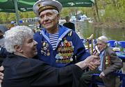 Soviet World War II veterans celebrate the victory 61 years ago over the Nazis by dancing in Gorky Park, a traditional Victory Day meeting place of veterans, in Moscow. President Vladimir Putin on Tuesday presided over the annual Red Square parade, paying homage to the sacrifice of elderly veterans but making no mention of the former Soviet Union's Western allies.