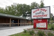 North Lawrence businesses Slow Ride Roadhouse Bar & Grill and Combs Custom Cycles, below, look to benefit from the opening of Riverfront Harley-Davidson.