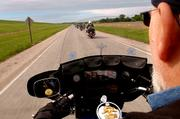 """Dave """"Slugo"""" Reed, Lawrence, rides with the local chapter of the Christian Motorcyclists Assn. on his Harley-Davidson motorcycle during a ride last week."""