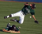 Free State High outfielder Travis Ice misplays a fly ball allowing a Lawrence High to score a run during the second inning.