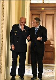 CIA Director nominee Gen. Michael Hayden, left, talks with Senate Minority Leader Harry Reid of Nev. on Capitol Hill Friday, May 12, 2006.