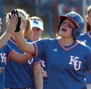 Kansas' Destiny Frankenstein collects high-fives after scoring against Nebraska on Friday, May 12, 2006, in the Big 12 softball tournament in Oklahoma City. Kansas beat Nebraska 2-0, with Frankenstein scoring both runs. Kansas advances to Saturday's championship game.