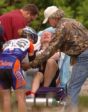 Auburn Flyers cyclist Shannon Fitzgerald is put on a stretcher as she is tended to by medical personnel after she was involved in the crash during the Womens' Division 1 Road Race Saturday at Lake Perry.
