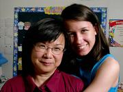 JoAnn Doll, a ninth-grader at Veritas Christian School, embraces her mother, Victoria, in the kindergarten classroom at Veritas where JoAnn attended class. Although showing affection isn't customary in Victoria's native Taiwan, JoAnn says she gets all the love she needs from her mother.
