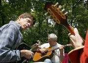 Mark Chambers, left, and Dave Gustafson, center jam out during the Third Annual Stringband Rendezvous. The Saturday afternoon event featuring live music and camping was held at West Bloomington Park.